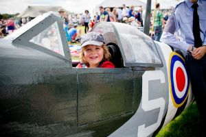 Child in spitfire cockpit